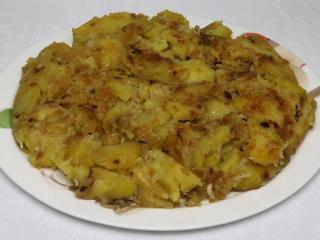 Duszone ziemniaki z wczesną kapustą